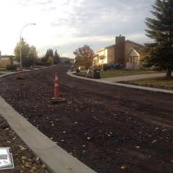 New curbs, gutters, sewer, water, and gravel prior to asphalt placement