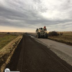 Turning old asphalt roadway back to granular surface.