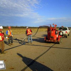 Hot pour crack sealing on runway