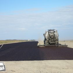 Fog coating private runway after chip seal helps retain the aggregate in place