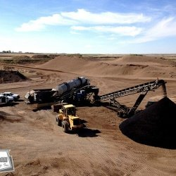 Here we are blending gravel and binder to be used as pothole material for a customer's internal consumption