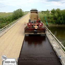 Chip Sealing bridge decks increases the skid resistance and adds years of life to the underlying structure