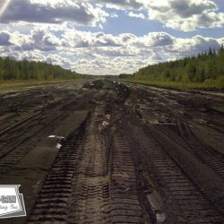In this picture the asphalt runway has been removed. The asphalt millings that came off the runway were processed and used as base material for site improvements reducing the requirement for non renewable resources