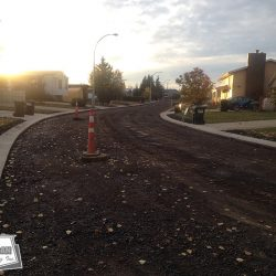 A road building project, prime coated and ready to be paved