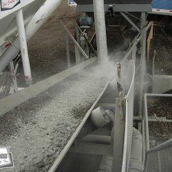 Blending dry bulk cement into custom pug mill mix