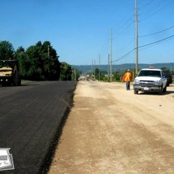 Paving recycled asphalt that has been recycled through the pugmill