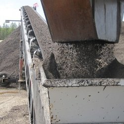 Once the product is mixed, it is then discharged onto a stacking conveyor to be stockpiled